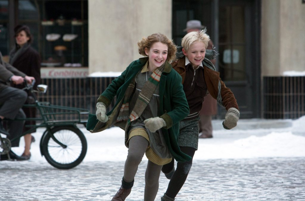 the book theif movie review If there can be such a thing as a sweet, reflective fable about death and the holocaust, the book thief is it based on the bestseller by markus zusak, the film tells the story of liesel meminger (sophie nélisse), a young girl left in the care of foster parents hans hubermann (geoffrey rush) and.